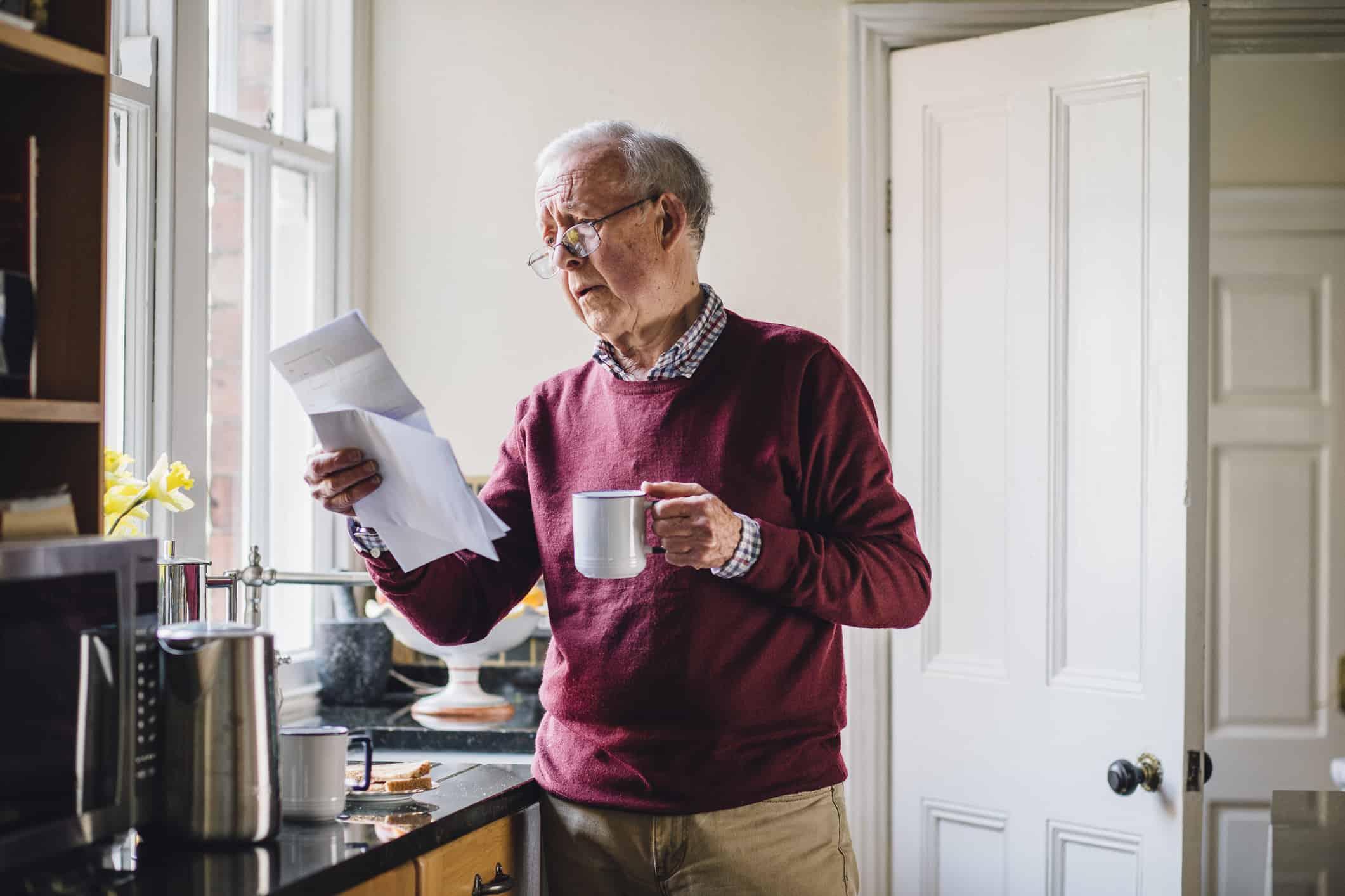 Senior citizen looking at bill