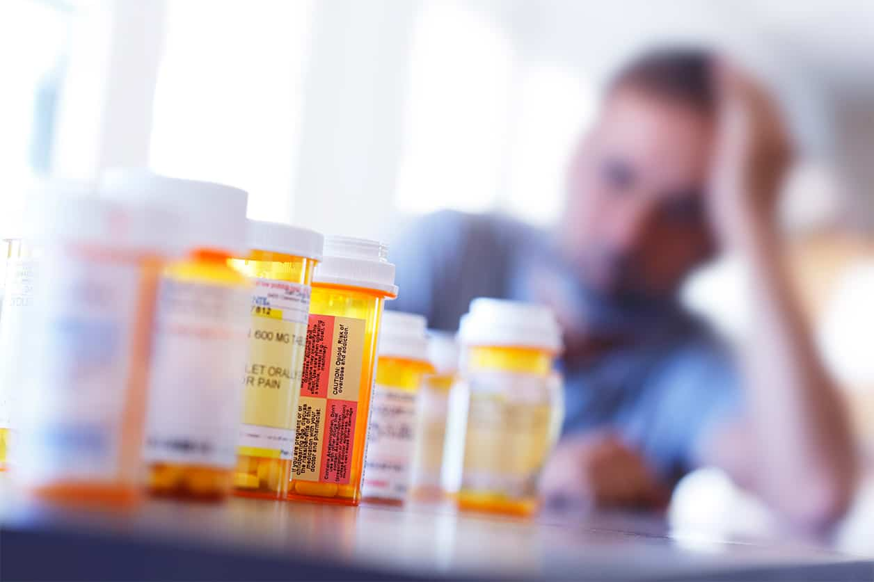 Picture of a lot of prescription medications (pill bottles)