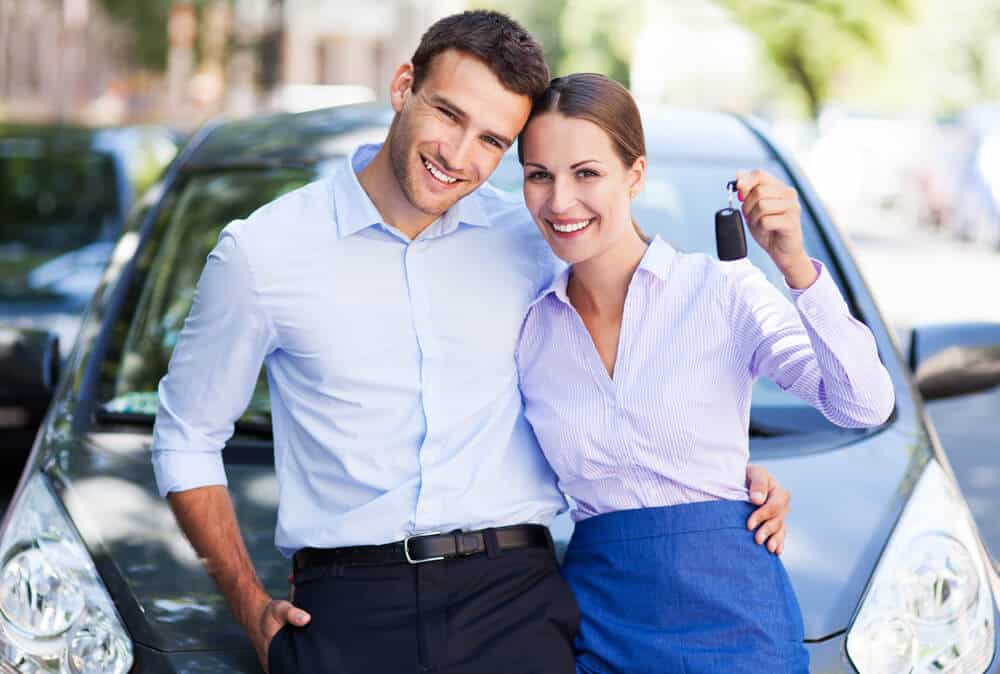 couple being happy about owning a car